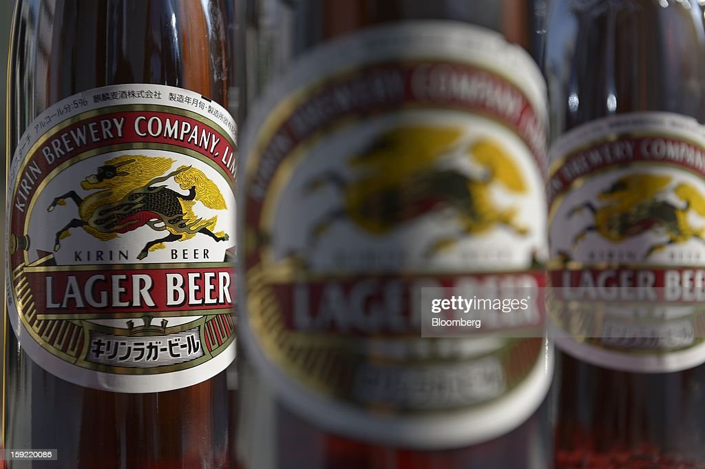 Bottles of Kirin Brewery Co. beer are arranged for a photograph in Kawasaki, Kanagawa Prefecture, Japan, on Wednesday, Jan. 9, 2013. Suntory, Kirin Holdings Co. and Asahi Group Holdings Ltd., have sought growth overseas as a declining population damps domestic demand. Photographer: Akio Kon/ Bloomberg