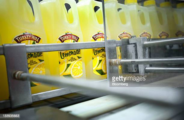 Bottles of lemonade move along a conveyer belt at Turkey Hill LP's production facility in Contestoga Pennsylvania US on Monday Nov 21 2011 Turkey...