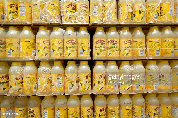 Bottles of lemonade sit on a pallet waiting to be prepped for packing at Turkey Hill LP's production facility in Contestoga Pennsylvania US on Monday...
