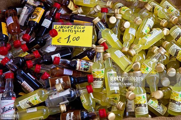 Bottles of limoncello for sale at market at Campo De' Fiori.