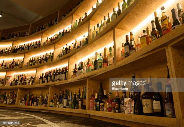 Bottles of liquor are displayed at the Amazon Bar operated by Amazon Japan KK during a media preview in Tokyo Japan on Thursday Oct 19 2017 For 10...