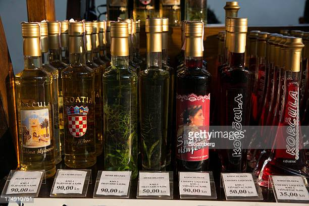Bottles of locally made brandies and cherry liqueurs stand for sale at a store in Korkula Croatia on Saturday July 27 2013 Croatia whose beaches...