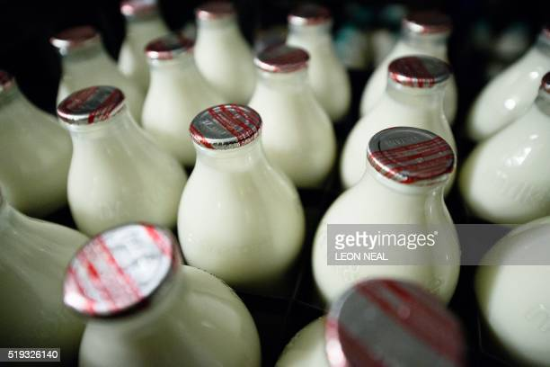 Bottles of milk are seen as Neil Garner a milkman for the MilkMore delivery company works on his daily round in the Watford area north of London on...