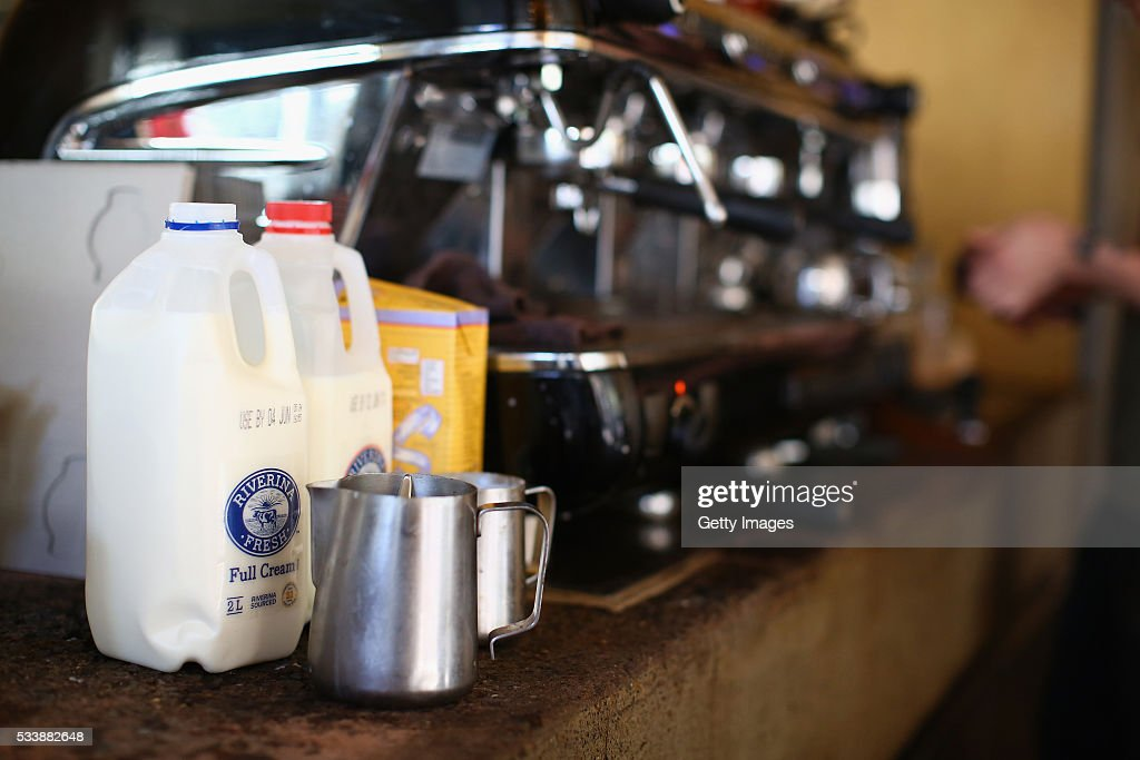Bottles of milk are seen in a cafe on May 24, 2016 in Sydney, Australia. Australians are rallying around it's dairy farmers by opting to purchase branded milk rather than the cheaper store brands after the country's largest dairy company Murray Goulburn last month cut the price it pays suppliers by 15%.