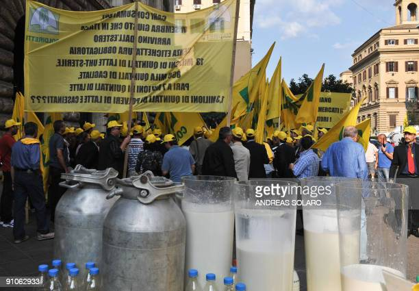 Bottles of milk line up as Italian farmers demonstrate in front of the Italian Agriculture Ministry in Rome on September 23 2009 Demonstrations have...