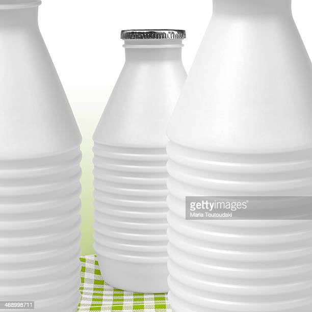 Bottles of milk on checkered tablecloth