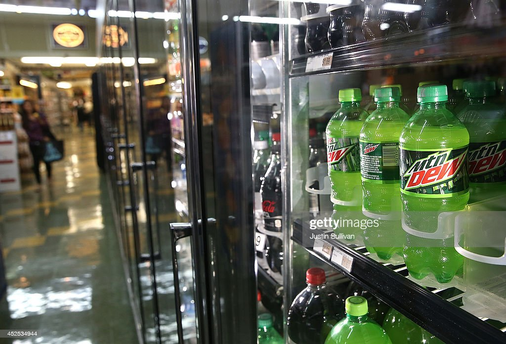 Bottles of Mountain Dew are displayed in a cooler at Marina Supermarket on July 22, 2014 in San Francisco, California. The San Francisco Board of Supervisors will vote on Tuesday to place a measure on the November ballot for a 2-cents-per-ounce soda tax. If the measure passes in the November election, tax proceeds would help finance nutrition, health, disease prevention and recreation programs.