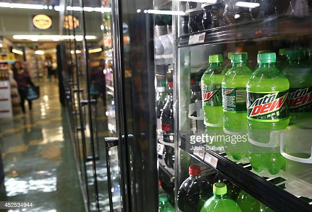 Bottles of Mountain Dew are displayed in a cooler at Marina Supermarket on July 22 2014 in San Francisco California The San Francisco Board of...