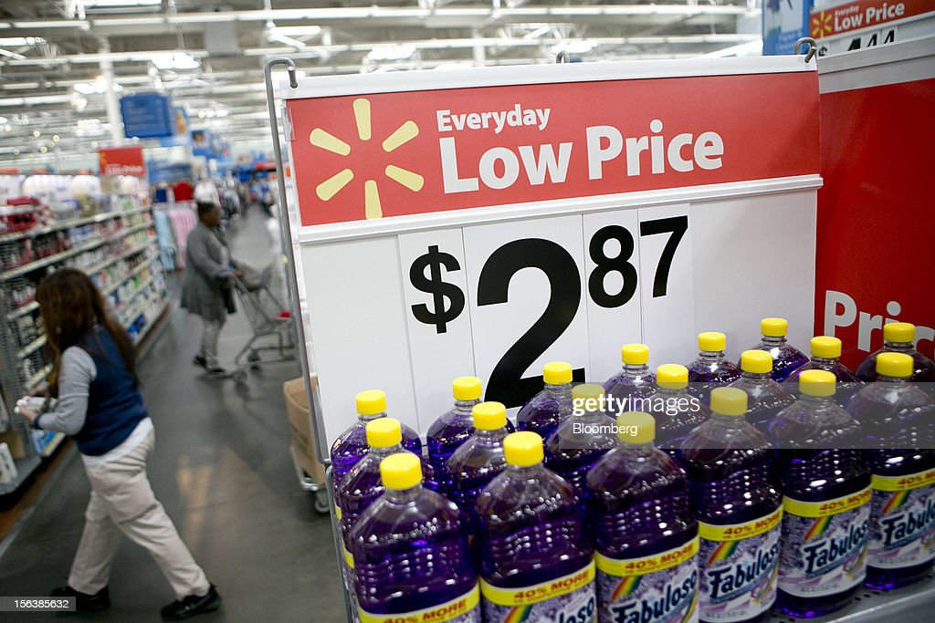 Bottles of multi-purpose cleaner sit on display next to a low price sign at a Wal-Mart store in Alexandria, Virginia, U.S., on Wednesday, Nov. 14, 2012. Wal-Mart Stores Inc. is scheduled to release earnings data on Nov. 15. Photographer: Andrew Harrer/Bloomberg via Getty Images