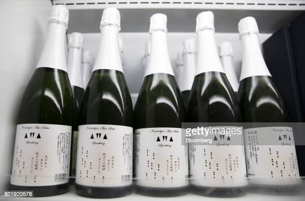 Bottles of NanbuBijin Awasake Sparkling sake brewed by NanbuBijin Co sit on display at the Japan Awasake Association booth during a Sake Marche event...