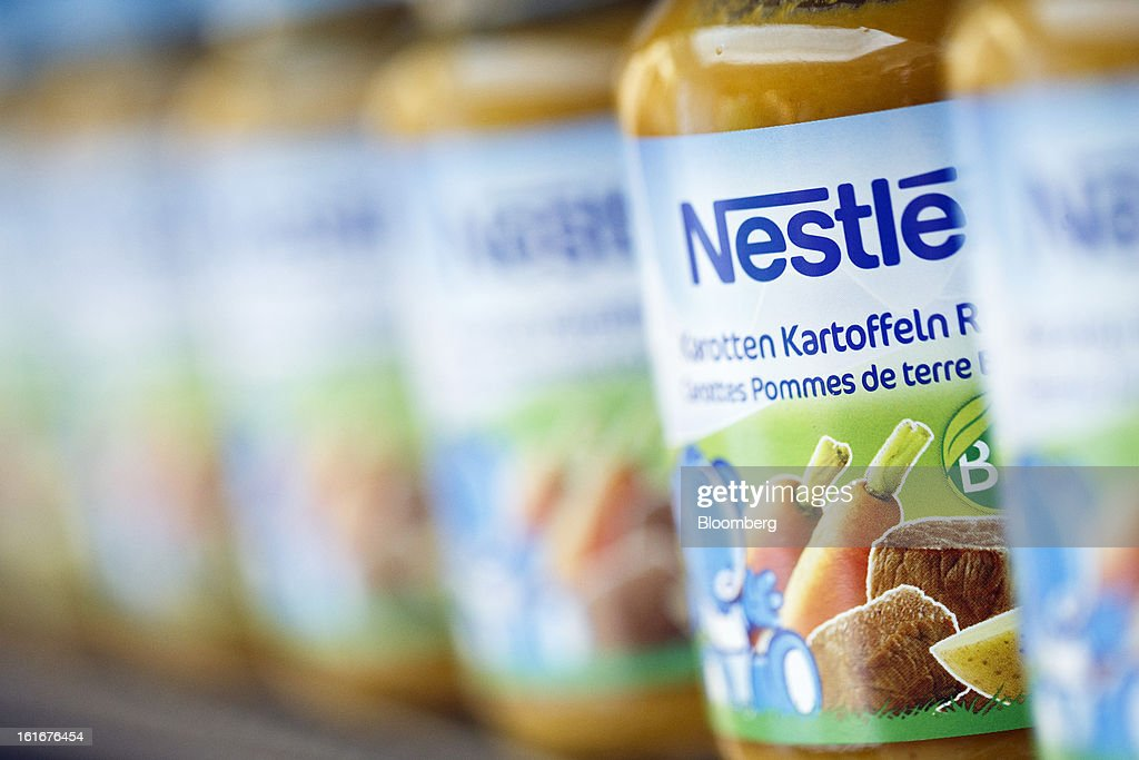 Bottles of Nestle baby food sit on display inside a store at the Nestle SA headquarters in Vevey, Switzerland, on Thursday, Feb. 14, 2013. Nestle SA said it expects 2013 to be as challenging as last year, when sales missed analysts' estimates on a slowdown in emerging markets, a region the world's largest food company is increasingly dependent upon. Photographer: Valentin Flauraud/Bloomberg via Getty Images