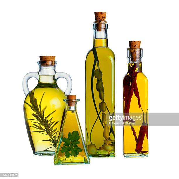 Bottles of Olive Oil with Herbs and Spices