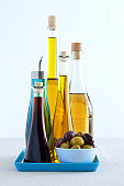 Bottles of olive oils and olives