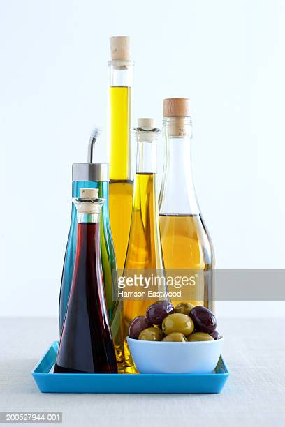 Bottles of olive oils and olives