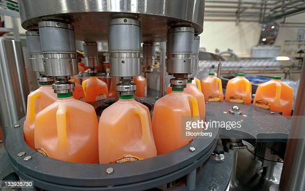 Bottles of orangeade move along a conveyer belt at Turkey Hill LP's production facility in Contestoga Pennsylvania US on Monday Nov 21 2011 Turkey...