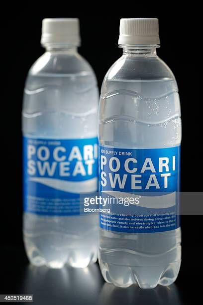 Bottles of Otsuka Pharmaceutical Co's Pocari Sweat health drink are arranged for a photograph in Tokyo Japan on Sunday July 20 2014 Otsuka the maker...