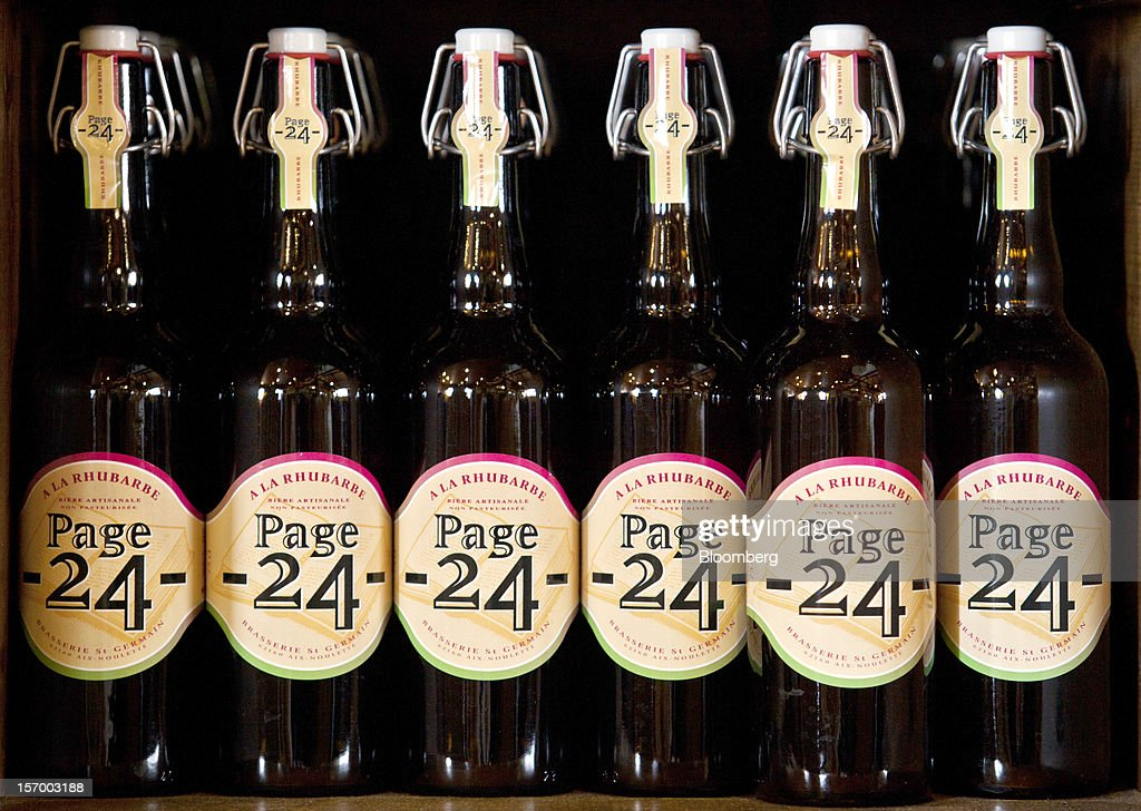 Bottles of Page 24 'A La Rhubarbe' beer, produced by the brewer Brasserie Saint Germain, are seen displayed for sale in the brewery store in Aix-Noulette, in France, on Monday, Nov. 26, 2012. Producers of beer in France, for instance, say any development plans they had have been 'nipped in the bud' by Hollande's plan to boost the tax on the drink next year. Photographer: Balint Porneczi/Bloomberg via Getty Images
