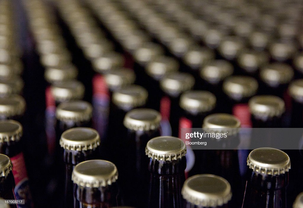 Bottles of Page 24 beer, produced by the brewer Brasserie Saint Germain, sit in pallets waiting for dispatch from the brewery in Aix-Noulette, in France, on Monday, Nov. 26, 2012. Producers of beer in France, for instance, say any development plans they had have been 'nipped in the bud' by Hollande's plan to boost the tax on the drink next year. Photographer: Balint Porneczi/Bloomberg via Getty Images