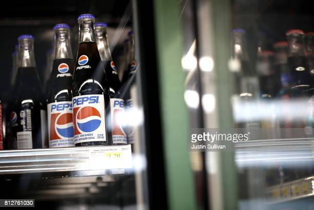Bottles of Pepsi soda are displayed on a shelf at Santa Venetia Market on July 11 2017 in San Rafael California PepsiCo reported a betterthanexpected...