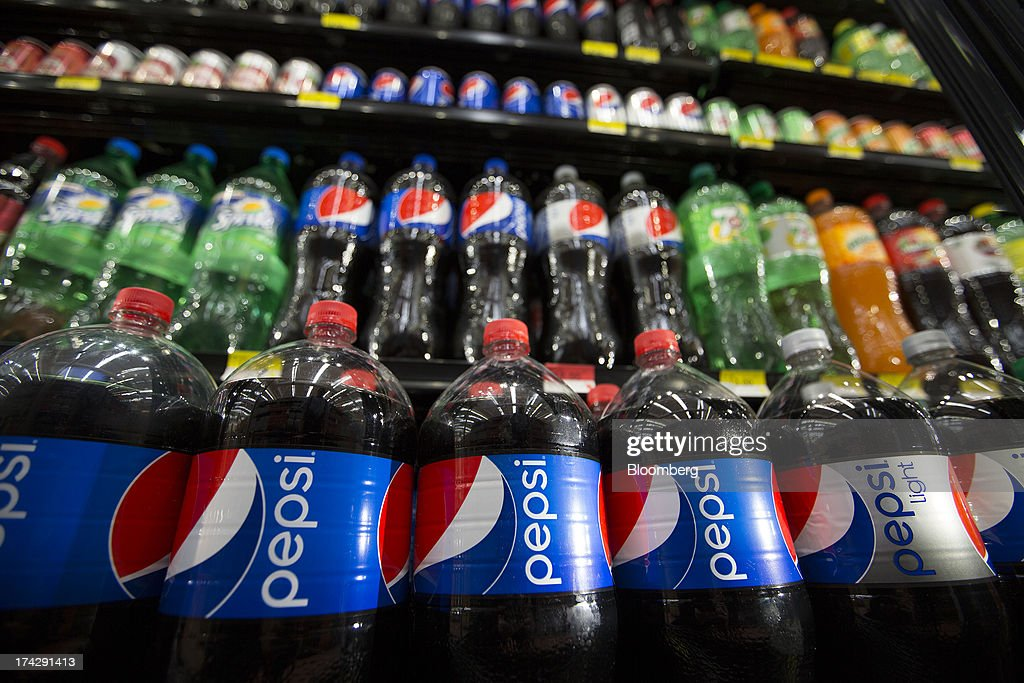 Bottles of PepsiCo Inc. Pepsi soft drinks sit on display at a store in Mexico City, Mexico, on Monday, July 22, 2013. PepsiCo Inc. is expected to release earnings data on July 24. Photographer: Susana Gonzalez/Bloomberg via Getty Images