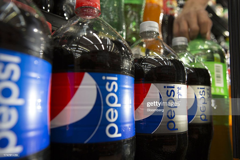 Bottles of PepsiCo Inc. soft drinks sit on display at a store in Mexico City, Mexico, on Monday, July 22, 2013. PepsiCo Inc. is expected to release earnings data on July 24. Photographer: Susana Gonzalez/Bloomberg via Getty Images