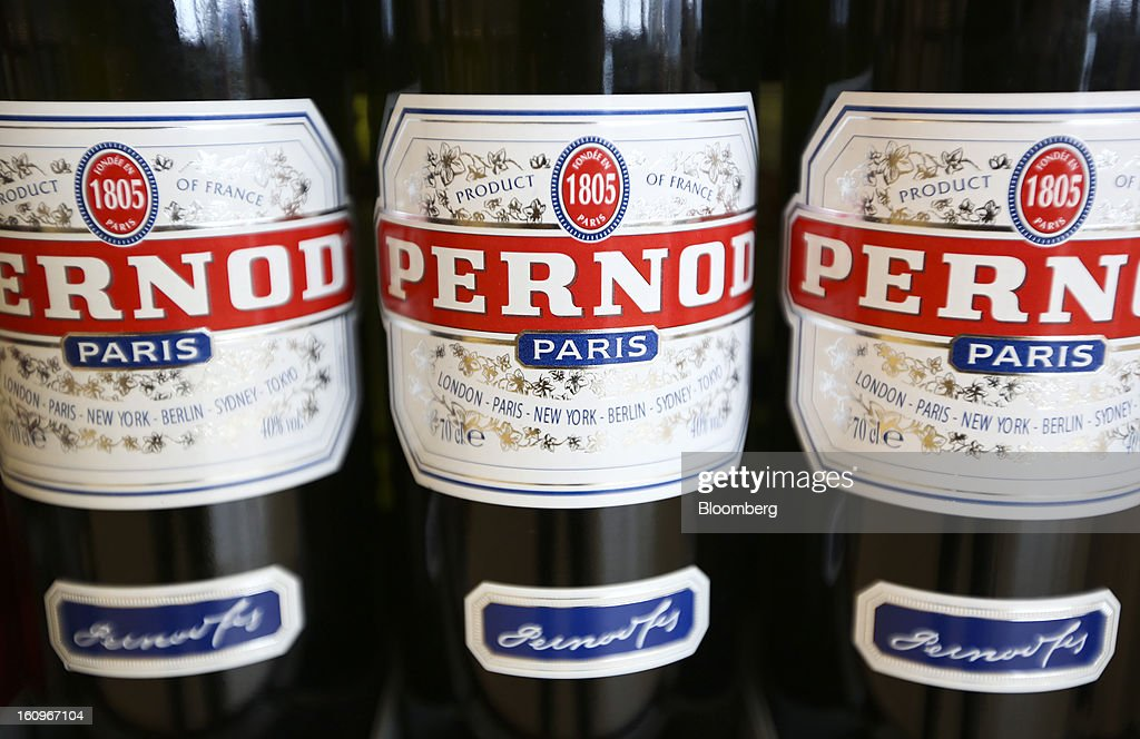 Bottles of Pernod, produced by Pernod-Ricard SA, sit on display inside a supermarket in London, U.K., on Friday, Feb. 8, 2013. Britain's economy will grow more slowly this year than previously forecast and stagnation may persist, according to the National Institute of Economic and Social Research. Photographer: Chris Ratcliffe/Bloomberg via Getty Images