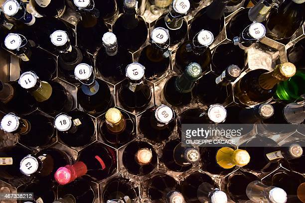 Bottles of Prosecco Valdobbiane superior are displayed for tasting on March 23 2015 at the Vinitaly exposition in Verona AFP PHOTO / GIUSEPPE CACACE
