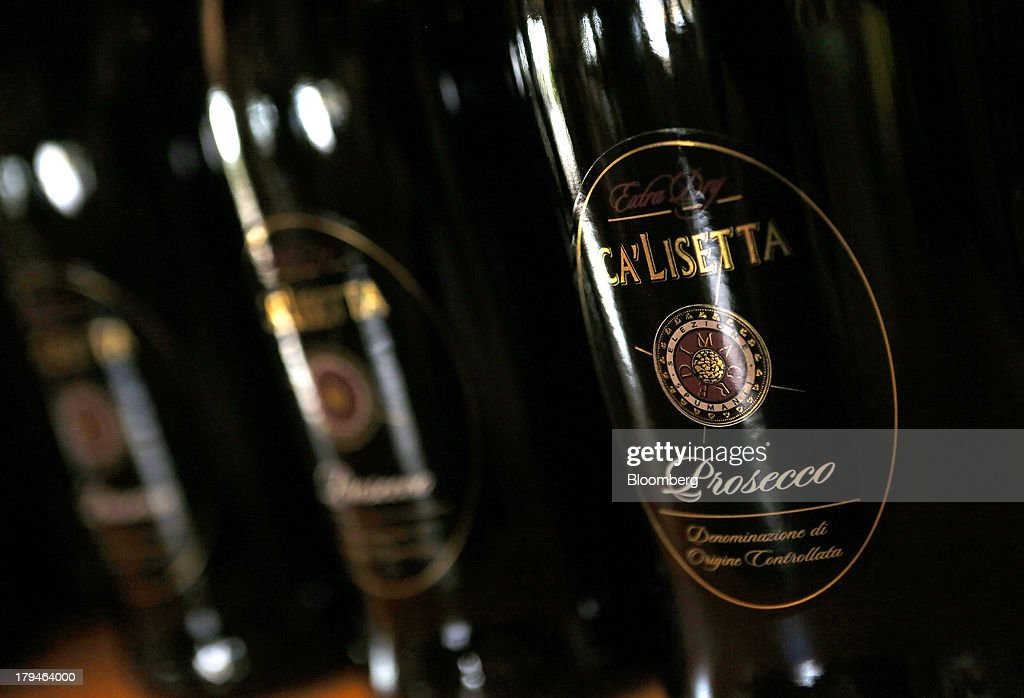 Bottles of Prosecco wine stand displayed for sale at the I Magredi vineyard in Pordenone, Italy, on Tuesday, Sept. 3, 2013. Italy's Agriculture Ministry has begun to investigate suspected sales of imitation Prosecco sparkling wine in its native Veneto region. Photographer: Alessia Pierdomenico/Bloomberg via Getty Images