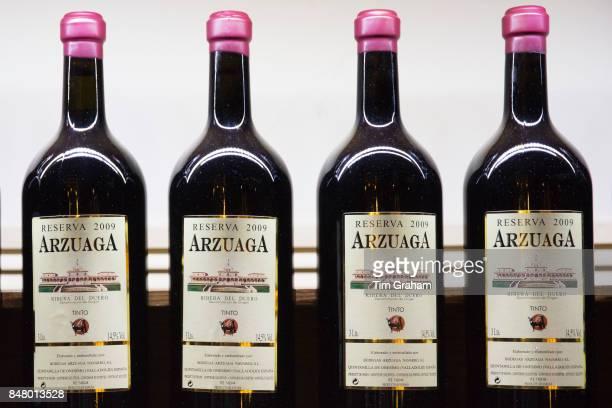 Bottles of red wine of Bodegas Arzuaga Reserva 2009 ribera del Duero wine production by River Duero Navarro Spain