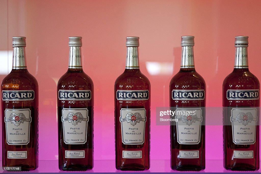 Bottles of Ricard pastis, produced by Pernod-Ricard SA, stand on a shelf in this arranged photograph at a bar near Archacon, France, on Tuesday, July 16, 2013. Distillers such as Diageo and Pernod Ricard SA are seeking to expand in emerging markets where booming economic growth is creating a burgeoning middle class with more disposable income. Photographer: Balint Porneczi/Bloomberg via Getty Images