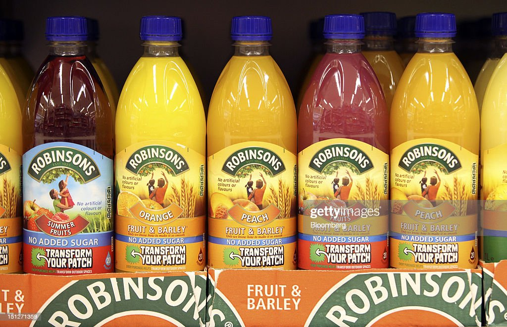 Bottles of Robinsons squash drink, manufactured by Britvic Plc, sit displayed for sale on a shelf inside a William Morrison Supermarkets Plc grocery store in Erith, U.K., on Wednesday, Sept. 5, 2012. Morrisons announced that 60 percent of store openings will be in southern England next year as it shifts attention from its northern heritage. Photographer: Chris Ratcliffe/Bloomberg via Getty Images
