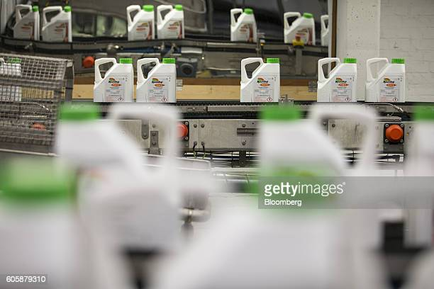 Bottles of Roundup weed killer move along conveyors on the production line at the herbicide manufacturing facility operated by Monsanto Co in Antwerp...