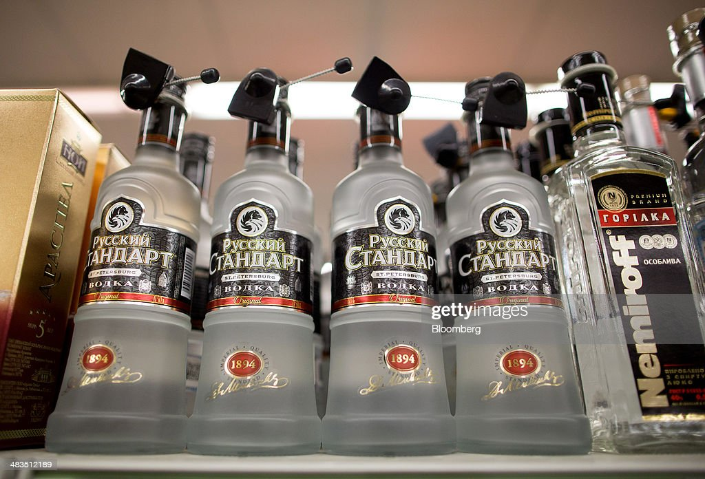 Bottles of Russian Standard vodka, produced by Russian Standard Corp., stand for sale with security tags attached inside a Dixy supermarket operated by OAO Dixy Group in Moscow, Russia, on Tuesday, April 8, 2014. Suppliers suffering from ruble depreciation this quarter are urging retailers to increase prices. Photographer: Andrey Rudakov/Bloomberg via Getty Images