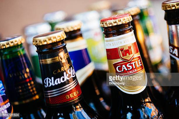 Bottles of SABMiller Plc beer brands including Castle and Carling Black Label sit in this arranged photograph at the company's brewhouse in the...