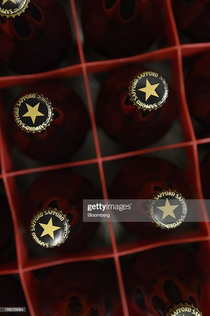 Bottles of Sapporo Breweries Ltd. beer are arranged for a photograph in Kawasaki, Kanagawa Prefecture, Japan, on Wednesday, Jan. 9, 2013. Sapporo is Japan's fourth-largest brewer. Photographer: Akio Kon/Bloomberg via Getty Images