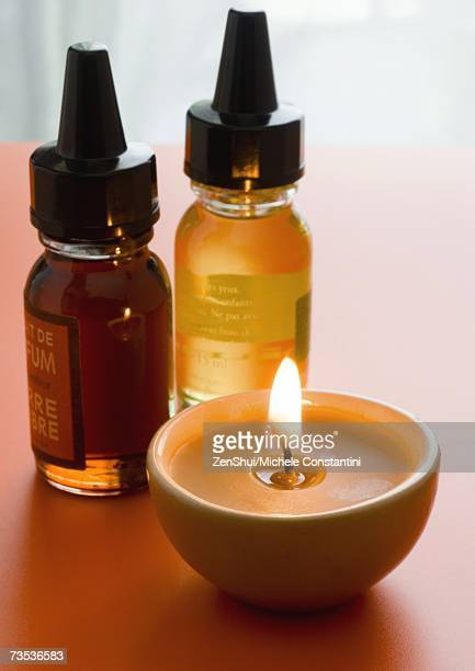 Bottles of scented oils and candle