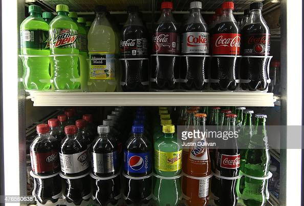 Bottles of soda are displayed in a cooler at a convenience store on June 10 2015 in San Francisco California The San Francisco board of supervisors...