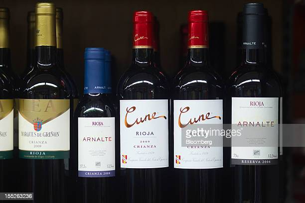 Bottles of Spanish red wine including rioja sit on a shelf at an Eroski Group supermarket in Madrid Spain on Friday Nov 2 2012 Spain is unlikely to...