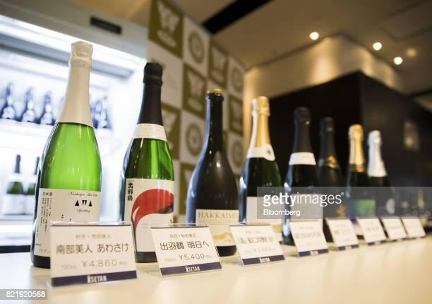 Bottles of sparkling sake including the NanbuBijin Awasake Sparkling brewed by NanbuBijin Co left are displayed at the Japan Awasake Association...