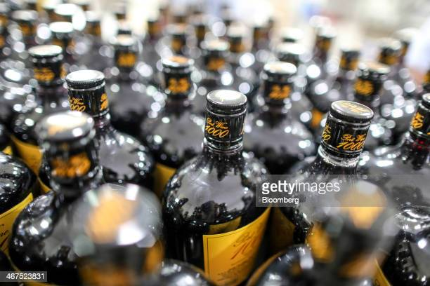 Bottles of Sula Port Wine 1000 sit in the labeling department at Sula Vineyards' production facility operated by Nashik Vintners Pvt in the Nashik...