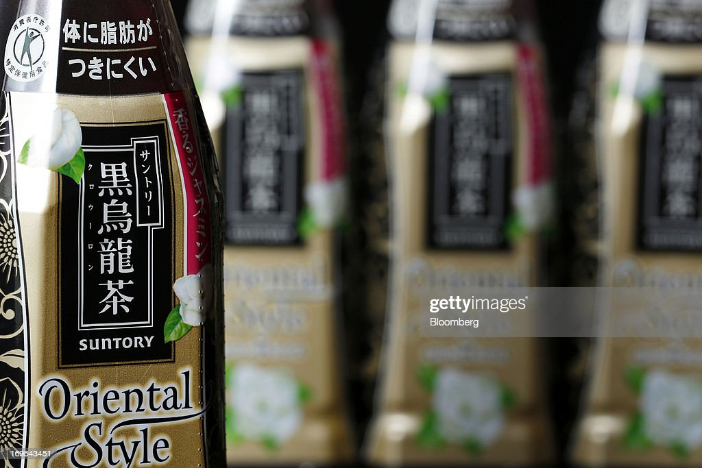 Bottles of Suntory Beverage & Food Ltd.'s Kuro Oolong tea are arranged for a photograph in Soka City, Saitama Prefecture, Japan, on Sunday, May 26, 2013. Nomura Holdings Inc., Morgan Stanley and JPMorgan Chase & Co. were selected as the lead banks to manage Suntory Beverage & Food Ltd.'s initial public offering, said two people with knowledge of the matter. Photographer: Kiyoshi Ota/Bloomberg via Getty Images