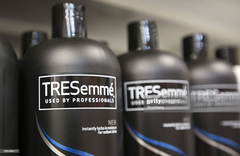 Bottles of TRESemme hair shampoos and conditioners, produced by Unilever NV, sit displayed for sale inside an Asda supermarket, the U.K. retail arm of Wal-Mart Stores Inc., in Watford, U.K., on Thursday, Oct. 17, 2013. U.K. retail sales rose more than economists forecast in September as an increase in furniture demand led a rebound from a slump the previous month. Photographer: Simon Dawson/Bloomberg via Getty Images