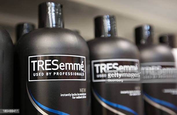 Bottles of TRESemme hair shampoos and conditioners produced by Unilever NV sit displayed for sale inside an Asda supermarket the UK retail arm of...