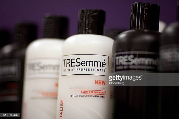 Bottles of TRESemme shampoos and conditioners produced by Unilever NV are seen inside a supermarket in Slough UK on Monday Sept 3 2012 UK retail...