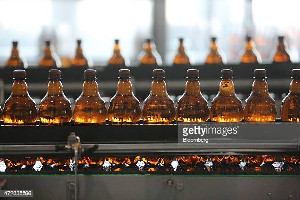 Bottles of Ukrainian brand 'Bochkove' beer move along the production line at the Moscow Brewing Co in Moscow Russia on Wednesday May 6 2015 The...