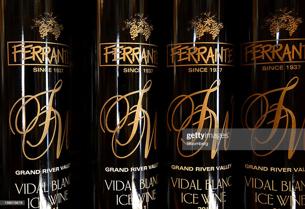Bottles of Vidal Blanc ice wine are displayed for sale at the Ferrante Winery in Geneva, Ohio, U.S., on Friday, Jan. 4, 2013. Ice wine is a type of dessert wine produced from grapes that have been frozen while still on the vine, because the sugars and other dissolved solids do not freeze, but the water does, this allows a more concentrated grape must to be pressed. Photographer: Ty Wright/Bloomberg via Getty Images