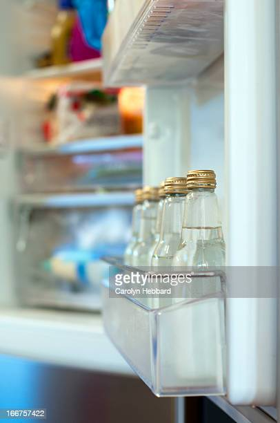 Bottles of Water in Refrigerator