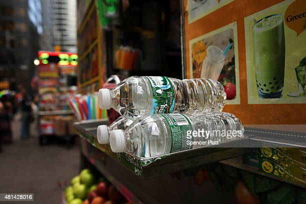 Bottles of water sit for sale at a street vendor on one of the hottest days of the summer on July 20 2015 in New York City More than 20000 homes and...
