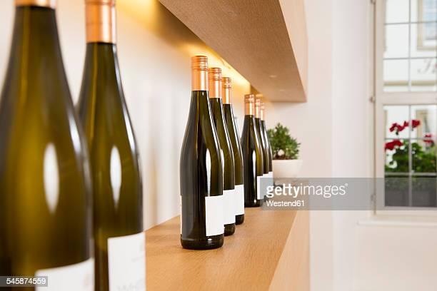 Bottles of white wine on shelf
