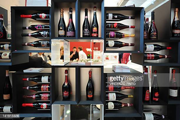 Bottles of wine are displayed on a stand on March 25 2012 at the Vinitaly exposition in Verona The 46th international wine and spirits exhibition...